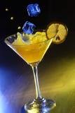 Orange cocktail. In disco light Stock Photos