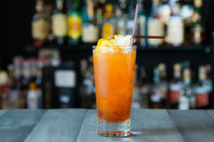Orange cocktail on the bar Stock Photos