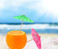 Orange cocktail on a beach. Orange cocktail on the beach, blurred background Royalty Free Stock Photography