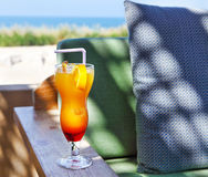 Orange cocktail on beach table Royalty Free Stock Photography