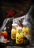 Orange cocktail for fHalloween parties. Orange cocktail in bottle for fHalloween parties Stock Photography