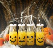 Orange cocktail in bottle for Halloween parties. Toned image Stock Photos