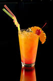 Orange cocktail with a cherry stock photos