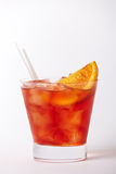 Orange cocktail drink with lemon and cherry. On white background Royalty Free Stock Image