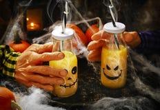 Orange cocktail for Halloween parties. Orange cocktail in bottle for Halloween parties Royalty Free Stock Image