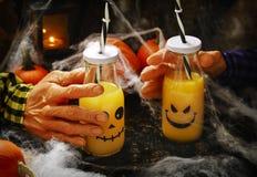 Orange cocktail for Halloween parties. Orange cocktail in bottle for Halloween parties Stock Photo