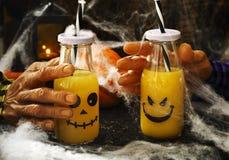 Orange cocktail for Halloween parties. Orange cocktail in bottle for fHalloween parties Royalty Free Stock Photo