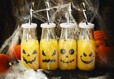 Orange cocktail for Halloween parties. Orange cocktail in bottles for Halloween parties Stock Image