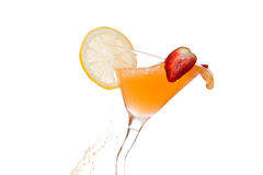 Orange cocktail with lime and strawberry on white. Cocktail with lime and strawberry Stock Photo