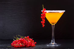 Orange cocktail with red currant Stock Photography