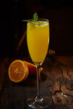 Orange cocktail on rustic wooden table Royalty Free Stock Photo