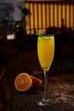 Orange cocktail on rustic wooden table Royalty Free Stock Images