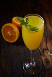 Orange cocktail on rustic wooden table Stock Images