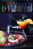 Orange cocktail with a straw. On the bar Stock Images