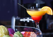 Orange cocktail with a straw. On the bar Royalty Free Stock Image