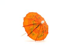 Orange cocktail umbrella #1. An orange cocktail umbrella, front view Stock Photography