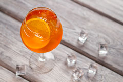 Orange cocktail in wineglass. Royalty Free Stock Photo