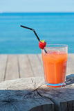 Orange cocktail on the wooden table Royalty Free Stock Photo