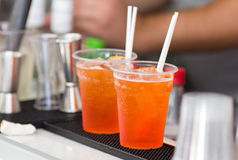 Orange cocktails on bar counter Royalty Free Stock Images