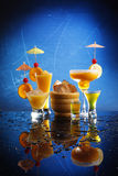 Orange cocktails on blue royalty free stock photos