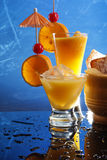 Orange cocktails on blue Royalty Free Stock Photography