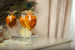 Orange cocktails decorated with physalis on retro table at home interior Royalty Free Stock Images