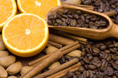 Orange, coffee beans and cinnamon Royalty Free Stock Photo
