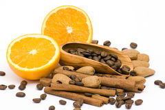 Orange, coffee, cinnamon and almonds Royalty Free Stock Photo