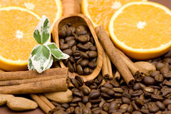 Orange, coffee, cinnamon and almonds Royalty Free Stock Photos