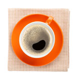 Orange coffee cup over kitchen towel Royalty Free Stock Photo