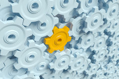 Orange cog or wheel standing out from the others. High quality 3d image of an orange cog or wheel standing out from the others Royalty Free Stock Photos