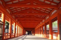 Orange colonnade leading to the temple of Miyajima (in the Hiroshima region, Japan) on the Itsakushima island as a symbo Stock Photo