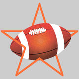 Orange color American football ball and an orange or brown star stock photo