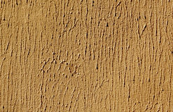 Orange color cement wall surface. Royalty Free Stock Images