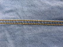 Chain stitch on jeans. Orange color chain stitch on blue color jeans stock images