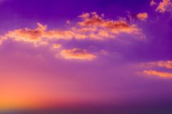 Orange color clouds on colorful sunset sky. Orange and purple color sky. Sun at horizon stock photo