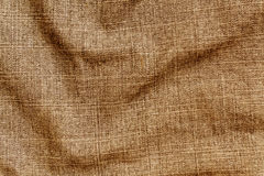 Orange color denim textile cloth surface. Royalty Free Stock Photos