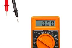 Multimeter isolated on white. Orange color electric Multimeter device on white desk royalty free stock photos