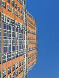 City view of big blue sky and facade of building exterior. stock images