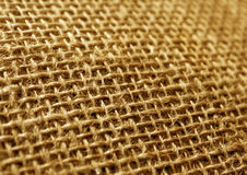 Orange color hessian cloth sack texture with blur effect. Royalty Free Stock Photos