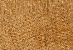 Orange color hessian sack cloth texture. Stock Photos