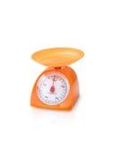 Orange color kitchen scale Stock Image