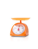 Orange color kitchen scale Stock Photos