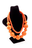 Orange color necklace. On black Mannequin Royalty Free Stock Images
