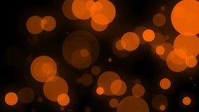 Orange color particles bokeh sparkles bubbles