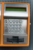 Orange Color Payphone using by call  close-up Number Pad Stock Image