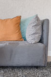 Orange color pillow on grey sofa in living room Royalty Free Stock Photography