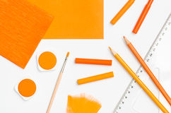 Orange color school supplies Stock Photography