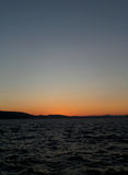 Orange color sunset afterglow on deep blue sky over the North Sea in Bergen. Norway stock images
