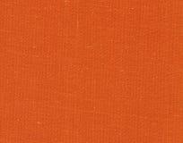 Orange color textile cloth texture. Royalty Free Stock Photos